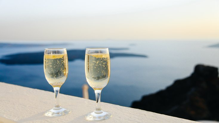 Two glasses of champagne at a destination wedding in Greece