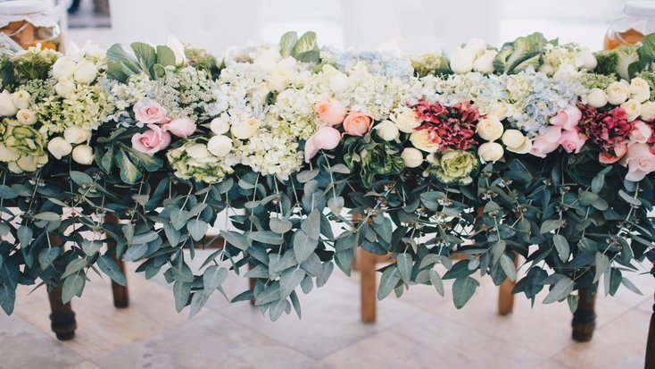 A row of bouquets at a spring wedding and outdoor wedding venue.