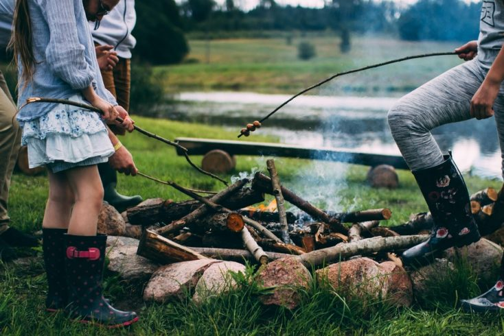 Family glamping around a campfire! The best campgrounds 'near me' await