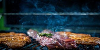 bbq food on the grill for family getaways