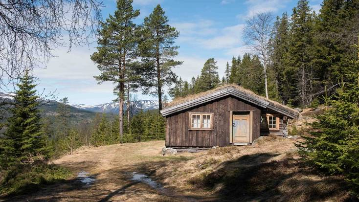 A log cabin in a forest clearing for a holiday in Norway and top winter escapes in Europe.