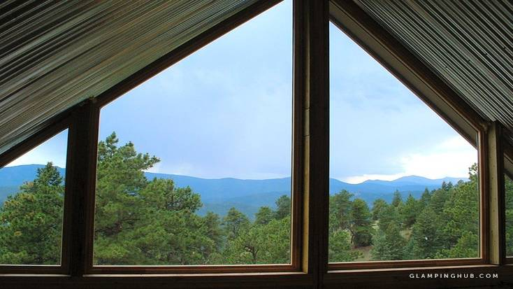 View of mountains from Colorado glamping rental perfect for romantic cabin winter getaways for two
