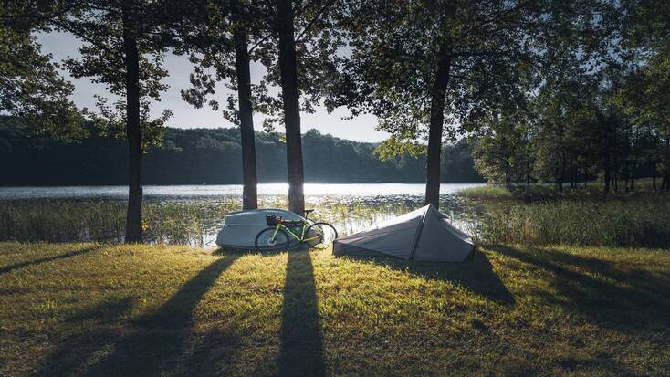 The best of tents in Australia! Tents like this beside the lake and woods