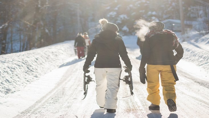 two people walking side by side on ski vacation in america, one of the best destinations for skiing, CO