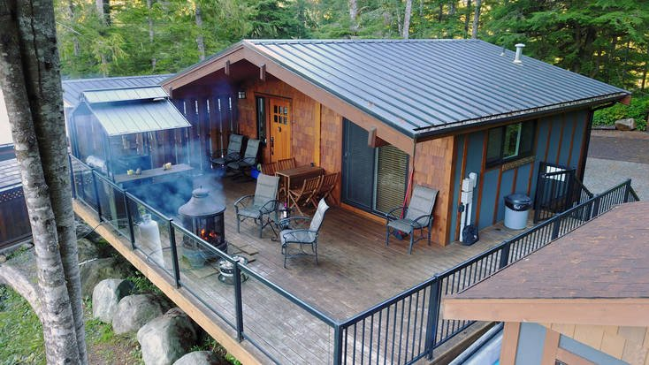 Aerial shot of a BC cabin rental with a hot tub and grill.