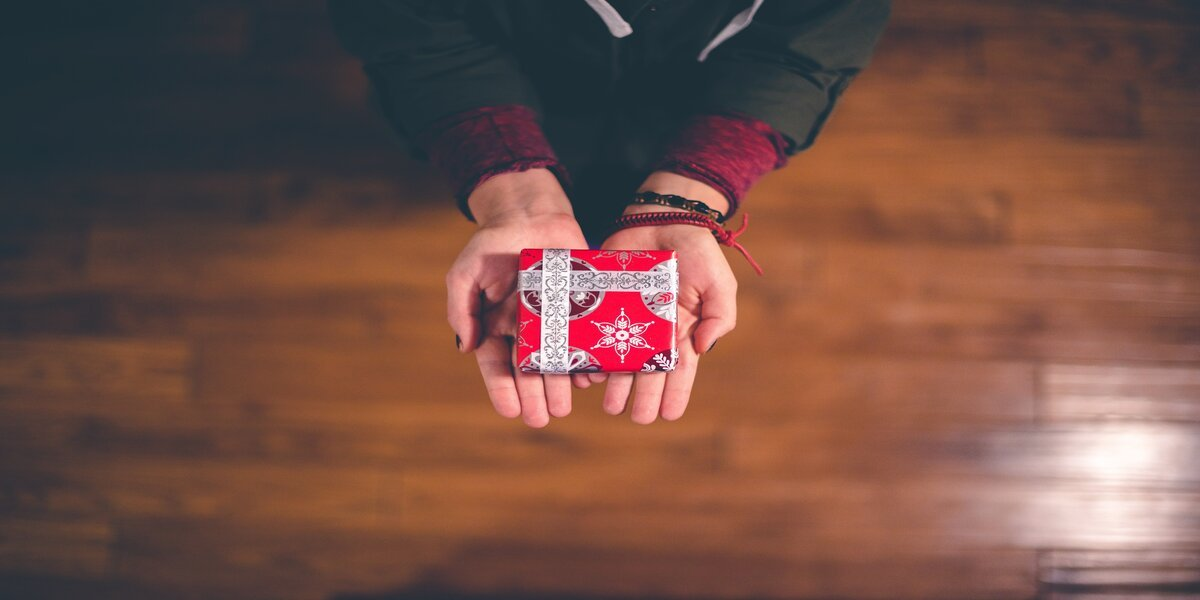 girl holding one of the gifts for people with too much stuff