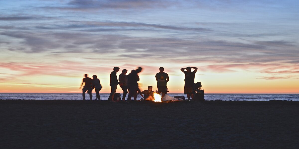 friends celebrating NYE on the beach together