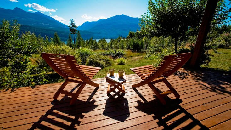 Two adirondack chairs overlooking Kootenay Lake, British Columbia