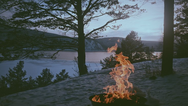 Fire in the forest, lit by people on a trip as part of the best east coast vacations fir couples in winter