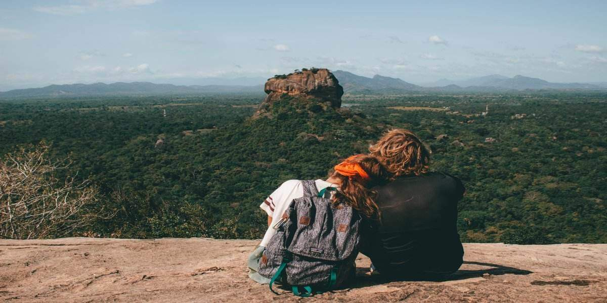 couple looking into distance during best gifts for people who love to travel experience