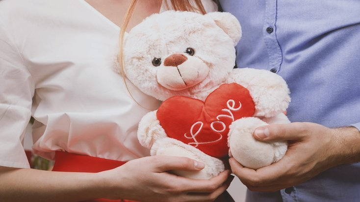 couple holding teddy on romantic getaway uk as part of things to do on Valentine's day this year in 2020