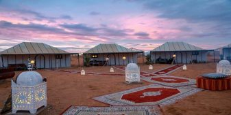 Moroccan tents in the desert for glamping and 2020 travel trends.