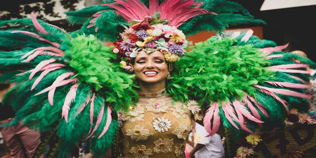 Woman enjoying Mardi Gras festival dressed in traditional costume for New Orleans parade