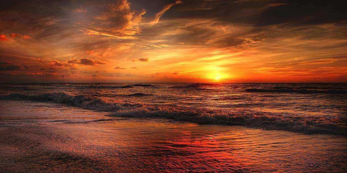 A beach at sunset