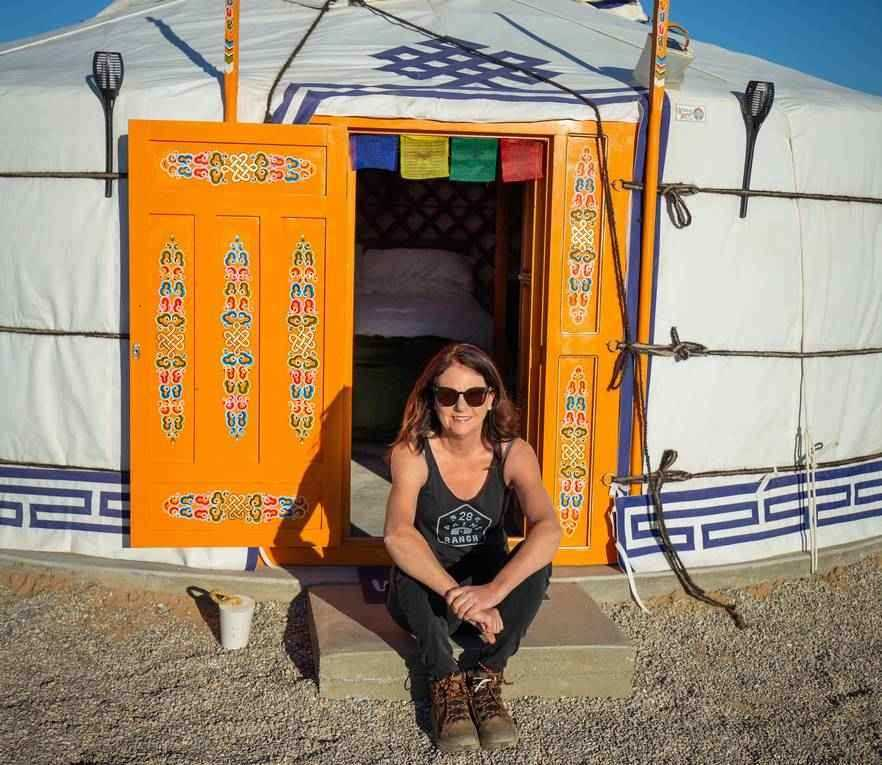 Erin, one of the inspirational women we work with, sitting outside one of the yurts