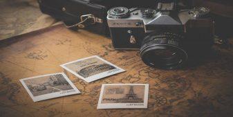 A camera, a map, and vacation photos .
