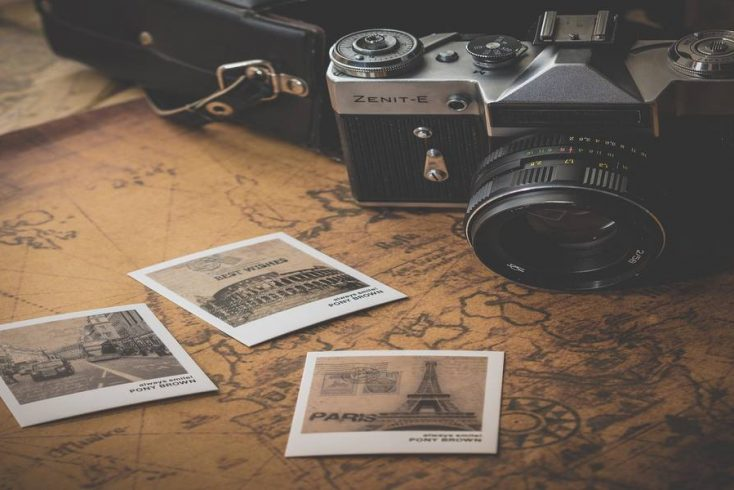 A camera, a map, and vacation photos .