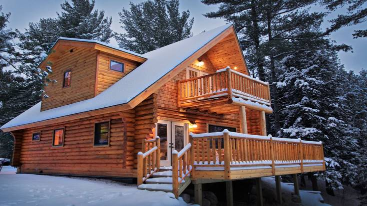 A gorgeous, snow covered Adirondack cabin rental.