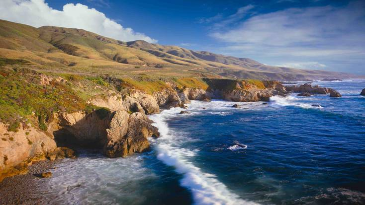Central Coast, California with waves  Of crashing against the rocky shoreline.