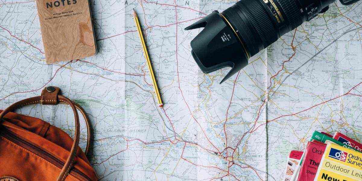 Discount travel preparation with map, camera and bag for last minute travel deals