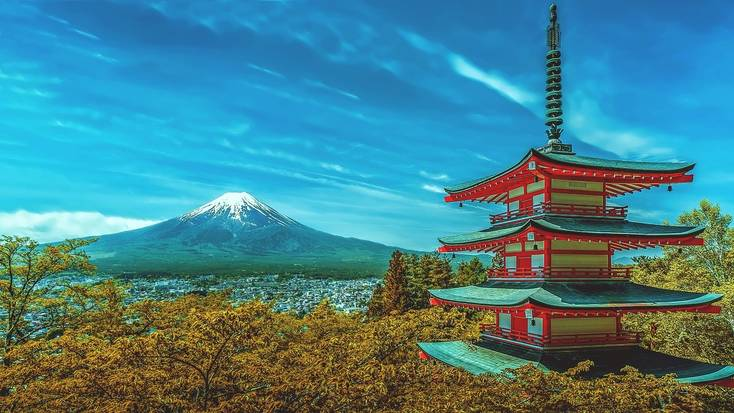 A pagoda in  Japan with views of the snow-capped Mount Fuji.