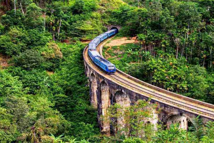 Image of blue train going through hills in the Sri Lankan New Year