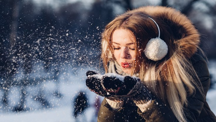 Woman wearing protection for winter, essentials for those looking to protect ears with earmuffs
