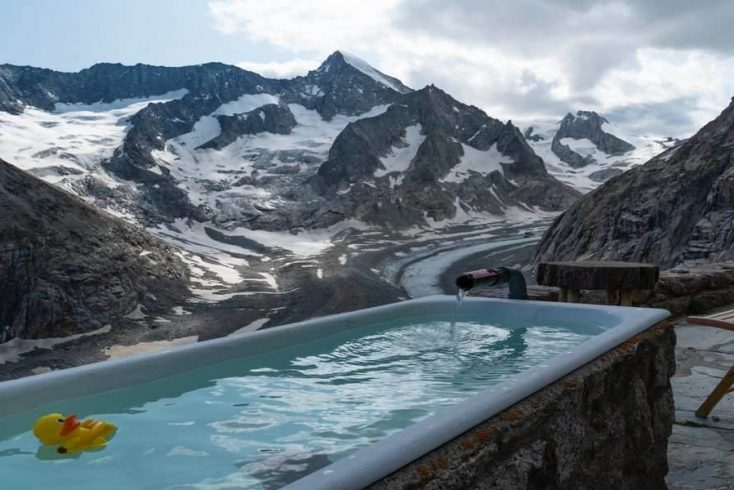 A outdoor hot tub with mountain views.
