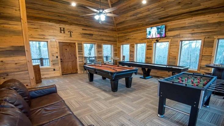 Vacation rental with a game room with a pool table and foosball.