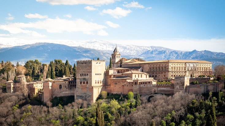 A shot of one of the top honeymoon destinations in Spain and the Alhambra palace from a distance.