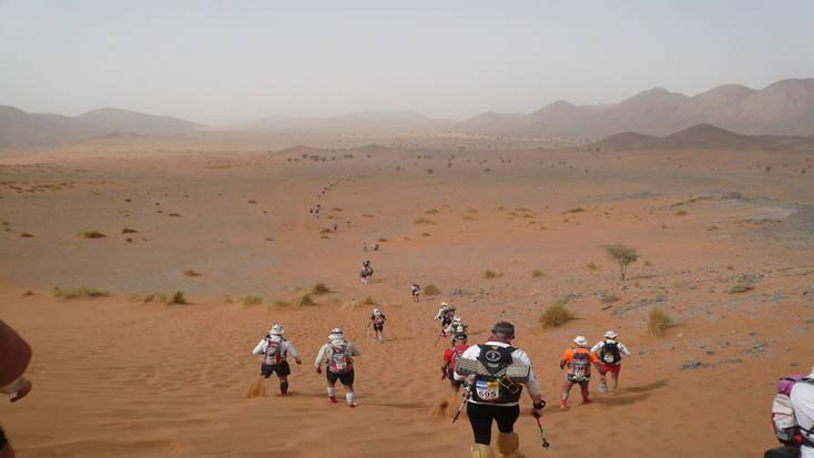 Competitors tackle a sand dune in the Marathon de Sables