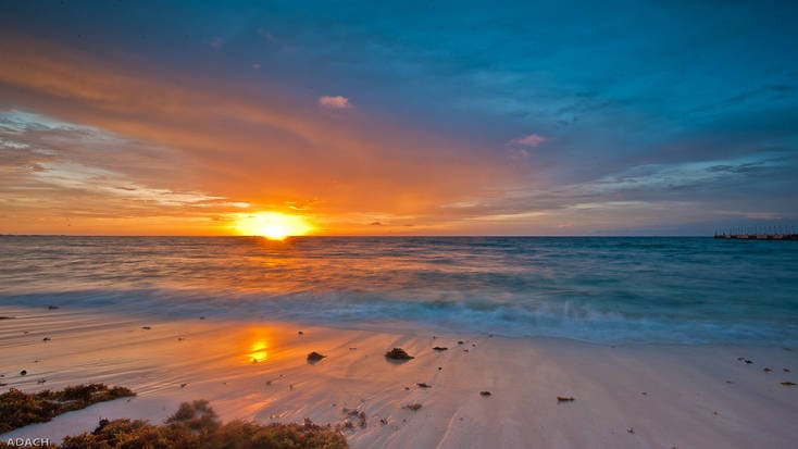 Spend spring break in Playa del Carmen and enjoy stunning sunset over the coastline
