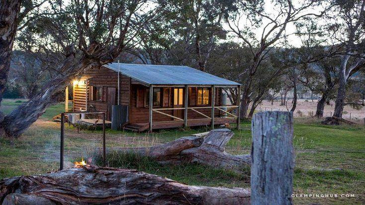 External view of camping Canberra rental with surrounding trees, perfect for Australia Day 2020.
