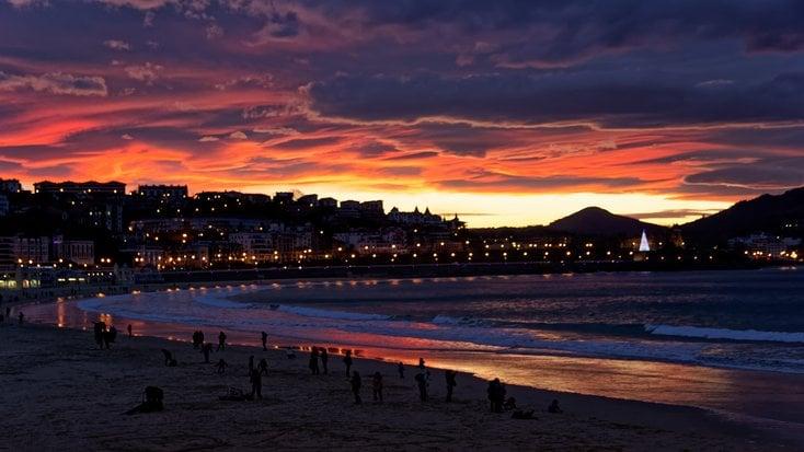 Beautiful view of San Sebastian as one of the top honeymoon destinations in Spain, at Playa de la Concha at night