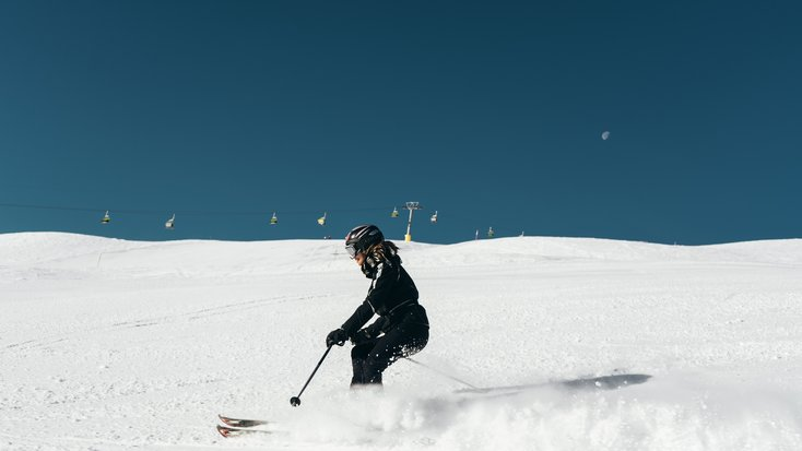 woman enjoys ruby mountain skiing with valentine, Nevada