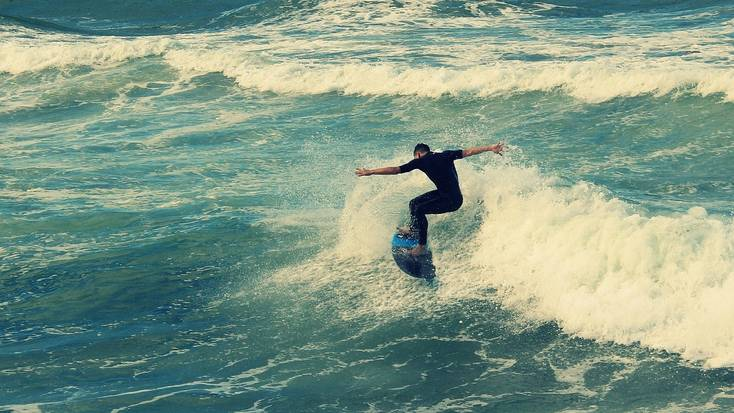 Try surfing on one of the beaches in Durban