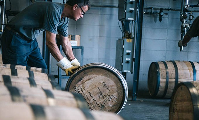 An employee barreling at Bardstown distillery
