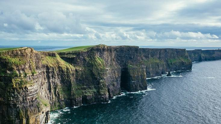 Visit the Cliffs of Moher during a summer vacation in Ireland