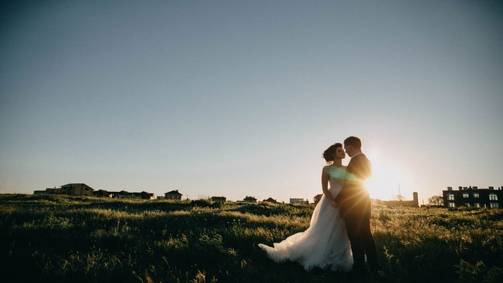 A bride and groom at sunrise in California.