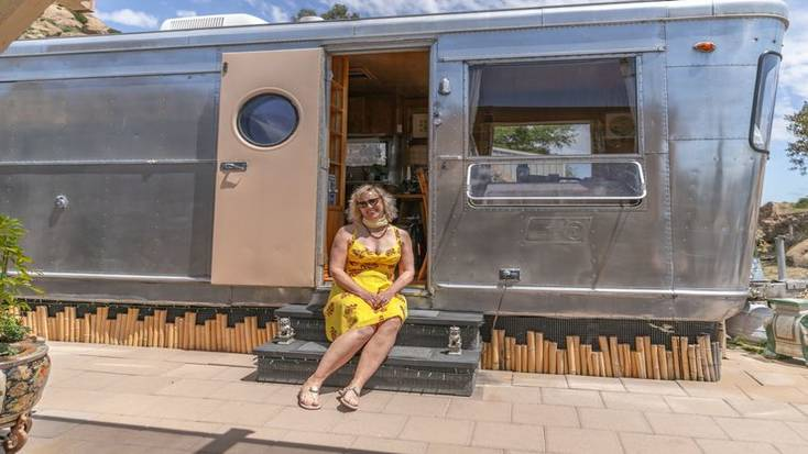 One of our female hosts of the month, Julia on the step of her travel trailer