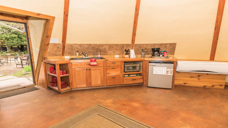 The fully-fitted kitchenette by the entrance of the tipi