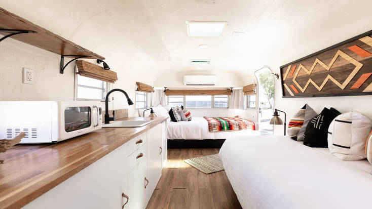 The modern interior of a sleek desert hot spring trailer rental in California