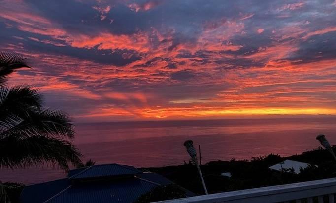 The sun setting over the ocean in Hawaii