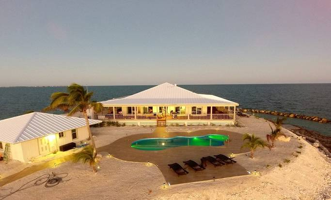 A private island rental with a modern accommodation and swimming pool