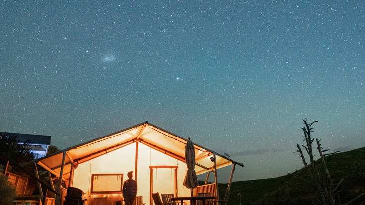 Travis stargazing in his secluded vacation rental
