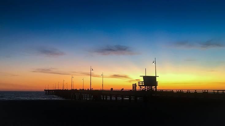 The boardwalk on Venice Beach, California, at sunset
