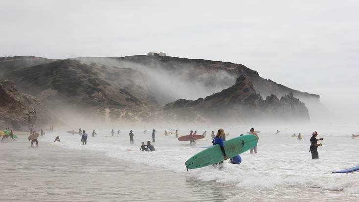 Surfers on the beach at Praia do Amado, Portugal
