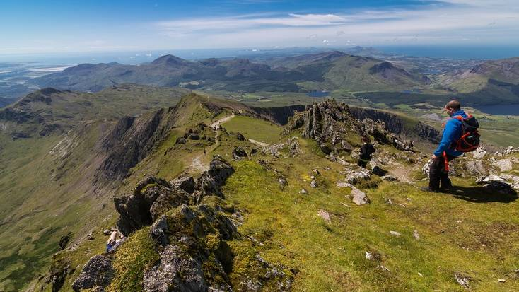 A hiker enjoying a route in Snowdonia National Park