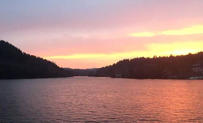 A view of a sunset over the Gatineau River with our Black Friday travel deals 2021