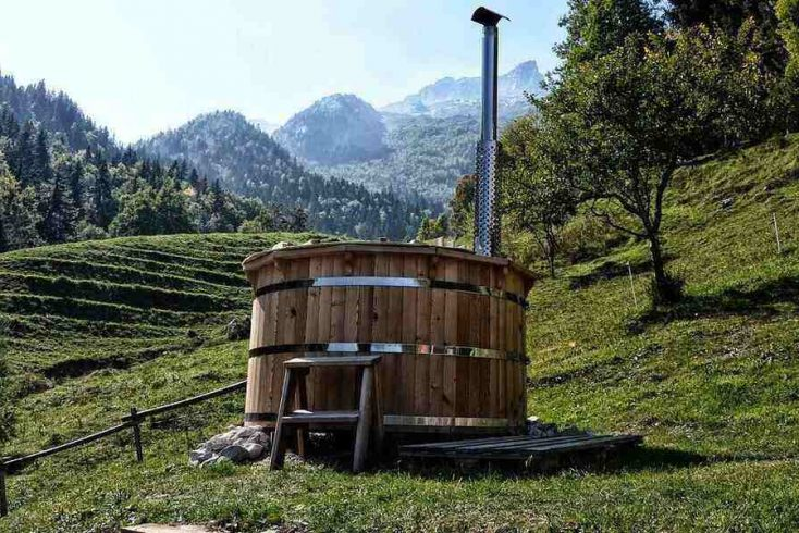 a hot tub in the mountains